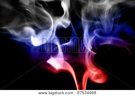 colored smoke on a black background with russian flag