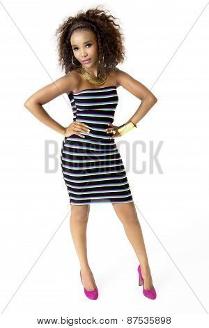 African Female Model Wearing Striped Dress, Gold Jewellery, Full Length
