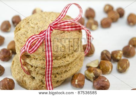 Oatmeal Cookie With A Ribbon And Hazelnuts