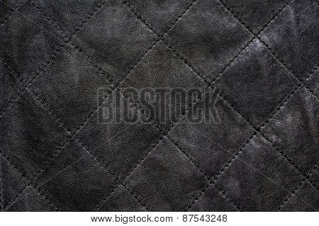 Gray natural leather stitched diagonally