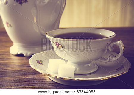 Old-fashioned Vintage Jug With Coffee With Wallpaper Background