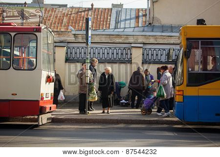 The Elderly Waiting For A Public Transport