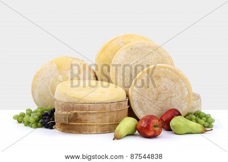 various types of form cheese with grapes, apple and pear