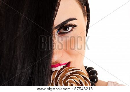 beautiful woman face with a lollipop