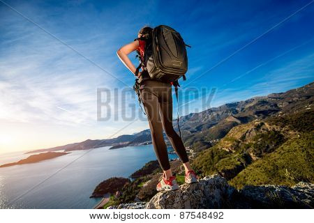 Sports woman on the top of mountain