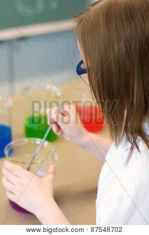 Young Woman Experimenting In A Laboratory