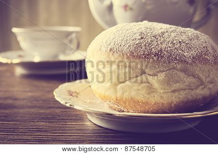 Macro Shot Of Donut With Cup Of Coffee On Table In Old-style