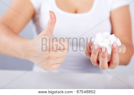 Woman Holds In Hand Of Sugar Cubes