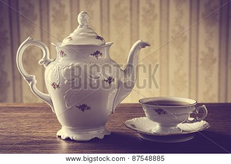 Old-fashioned Vintage Jug With Tea With Wallpaper Background