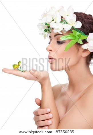 Young Beauty With Perfect Skin Wearing A Crown From Flowers
