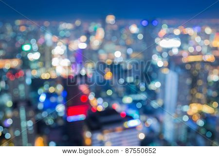 Aerial view of city night lights, abstract blurred bokeh background