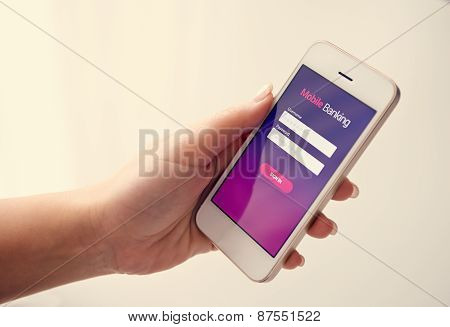 Female Hand Using Mobile Banking