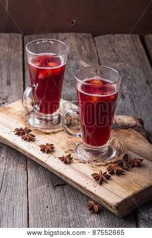 Mulled Wine On Wooden Board And Ancient Table