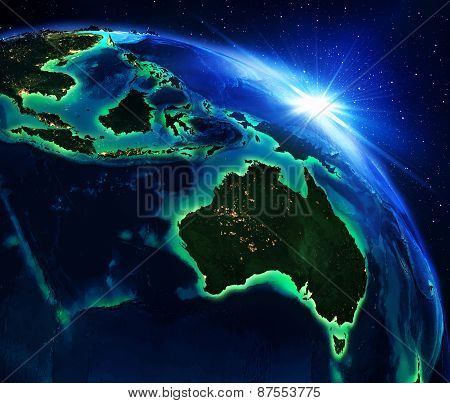 land area in Australia and Indonesia, the night