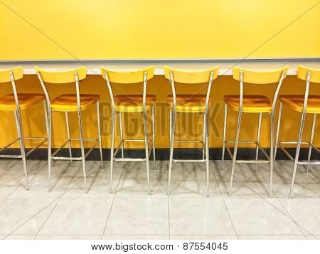 Raw Of Yellow Chairs In A Cafeteria