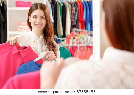 Female shopper looks at the mirror