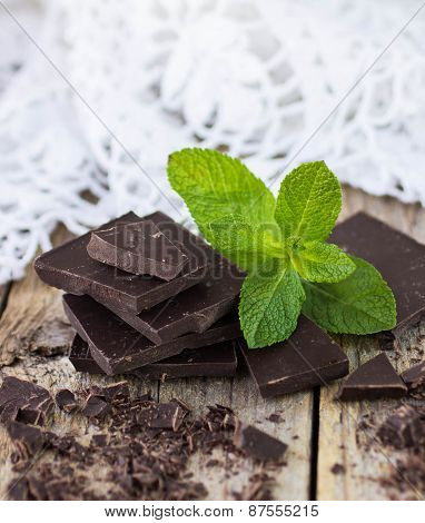 Chocolate and mint on wooden table
