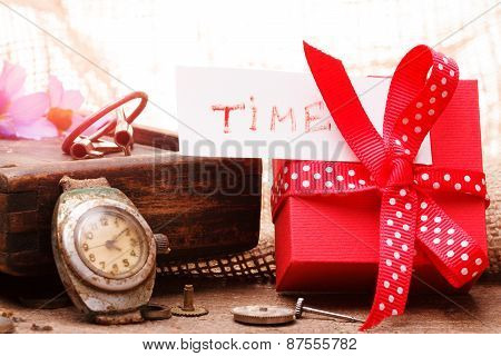 Red Gift Box Tied Red Ribbon And Text