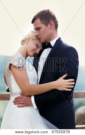 Bride Bent Shoulder. Wedding Couple On Mountain