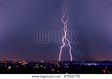 Lightning Strike Over Dark Blue Sky In Night City
