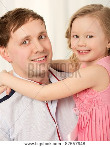 Lovely portrait of father and little daughter