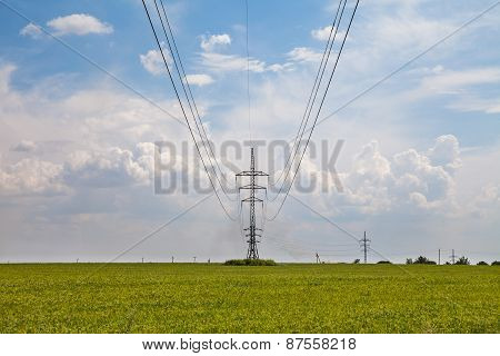Pillar aerial electrical lines in the green field