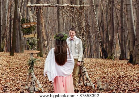 Bride And Groom In The Wedding Ceremony In Forest Near The Decorate Arch