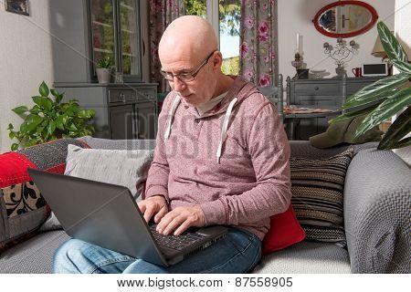 A Senior Man With A Laptop