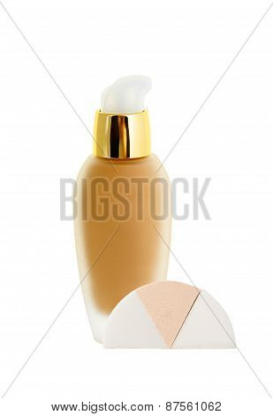 Cosmetic Liquid Foundation And Sponges Isolated On White