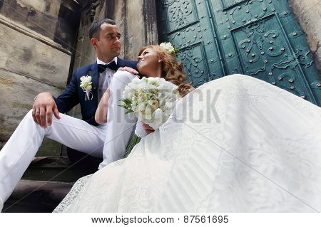 Beautiful Brunette Bride Sitting On Stairs