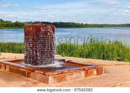Fountain With Drinking Water At The Lake In Summer Sunny Day