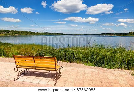 Lonely Bench By The Lake In Summer Sunny Day