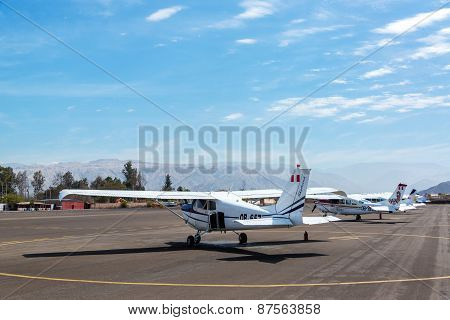 NAZCA PERU - OCTOBER 26: Airplanes at Maria Reiche Neuman Airport in Nazca Peru waiting to take tourists over the Nazca Lines on October 26 2014