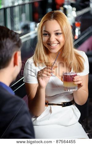 Couple has a drink in bar
