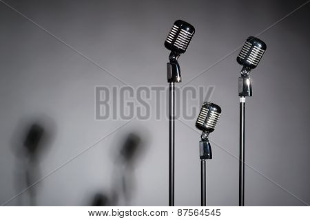 Three Old Fashioned Microphones With Space For Text