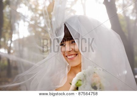 Wedding Portrait Of Beautiful Fashion Bride Close-up In The Autmn Park
