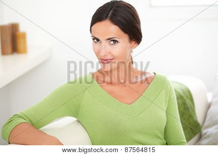Woman Contemplating While Looking At Camera