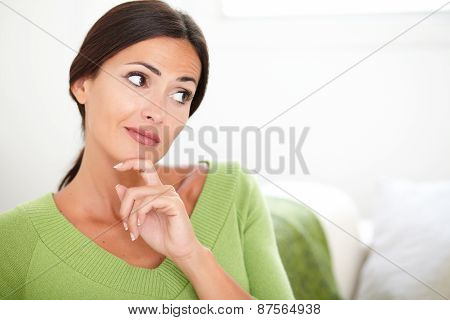 Confident Woman Thinking While Looking Away