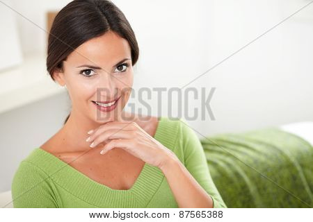 Cheerful Woman In Green Shirt Looking At Camera