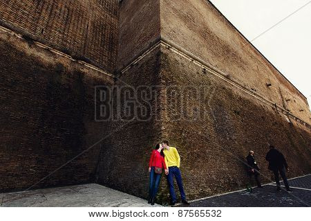 Romantic Couple Lovers At Brick Wall In Vatican, Italy. Italian Vacation For Honeymoon Or Weekend Ge