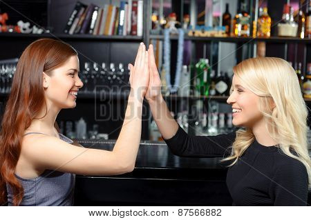 Women spend time in a bar