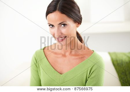 Young Woman With Toothy Smile Looking At Camera
