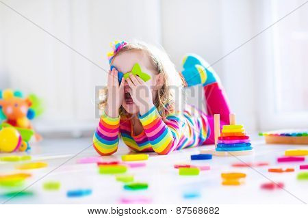 Little Girl Playing With Wooden Toys