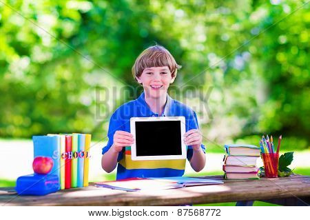 Child With Tablet Computer On School Yard
