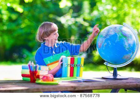 Child Studying In School Yard
