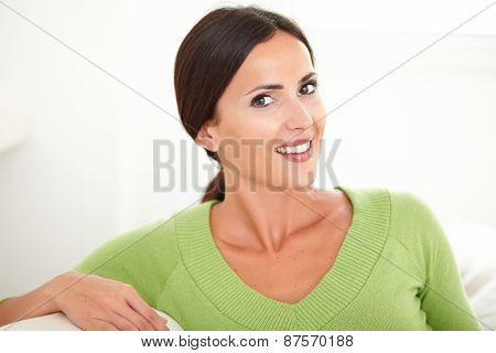 Young Woman In Green Shirt Looking At Camera