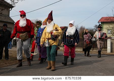 TURNOV, CZECH REPUBLIC - MARCH 5, 2011: People attends traditional Bohemian carnival procession called Masopust in Vsen near Turnov, Czech Republic.