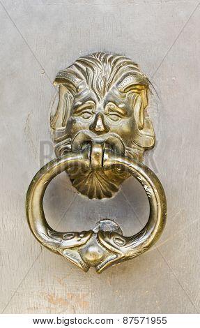 Brass Door Knocker On An Old Building Entry Door
