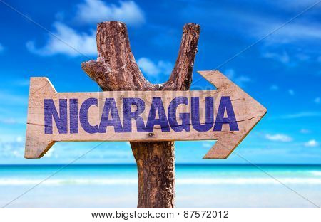 Nicaragua wooden sign with beach background