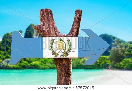 Guatemala Flag wooden sign with beach background